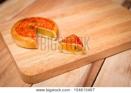 Moon Cake,chinese Mid Autumn Festival Dessert. On Wooden Table