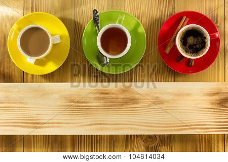 cup of coffee and tea on wooden background