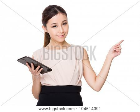 Asian businesswoman hold with tablet and finger point up