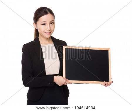 Asian Young businesswoman show with blackboard