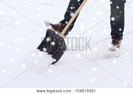 transportation, winter, people and vehicle concept - closeup of man digging snow with shovel