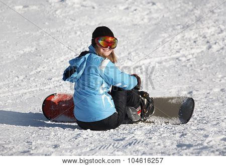 Happy Young Female Snowboarder