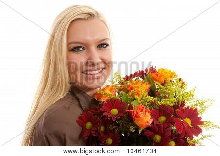 Young Blonde Woman With Bouquet Of Flowers