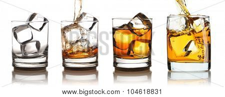 Whiskey in glass with ice set isolated on white