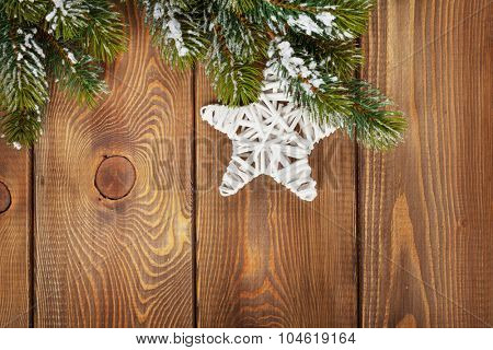 Christmas fir tree and star shape decor on rustic wooden board with copy space