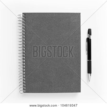 Notebook And Pen Isolated On White Background.