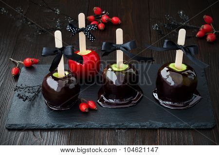 Black and red poison caramel apples. Traditional dessert recipe for Halloween party. Selective focus