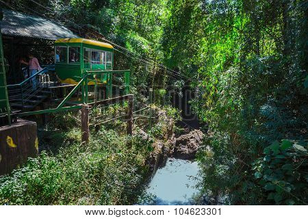 Unidentified Tourists Move In A Cable Car Above Datanla Waterfall