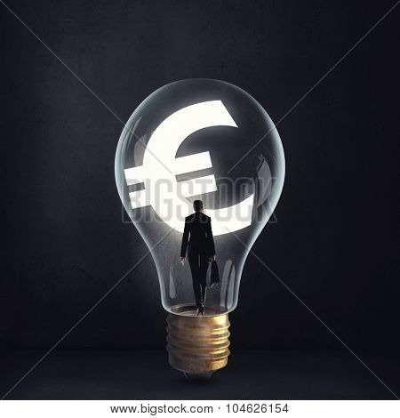 Woman holding luminous idea inside light bulb