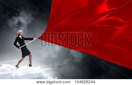 Santa woman in suit pulling red clothing banner