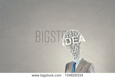 Businessman in suit with light bulb instead of head