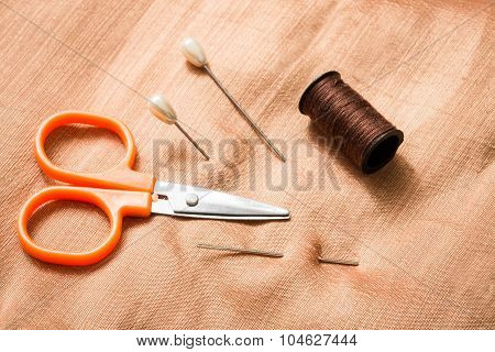 Tailor Tools Over Silk Tissue