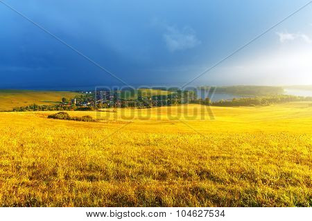Idyllic summer landscape with lake and green and yellow meadow. Central Europe