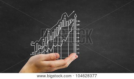 Human hand presenting on palm growing income chart