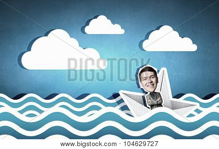 Businessman escapes from the crisis on paper boat