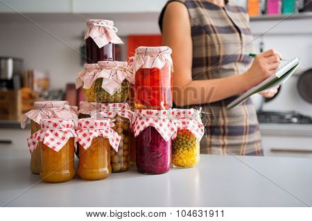Closeup Of Preserved Vegetables In Glass Jars On Kitchen Counter