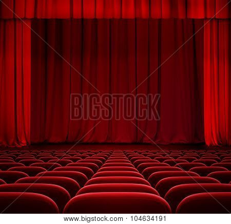 red curtain on theater stage with red velvet seats