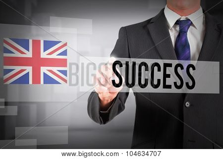 The word success and businessman in suit pointing finger against abstract white room