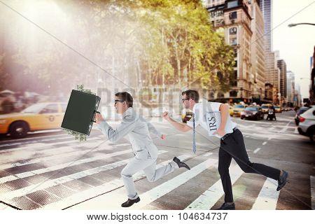 Running businessman against new york street