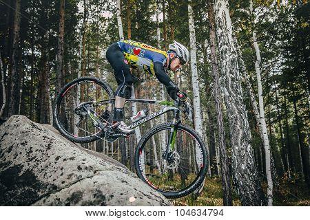 cyclist Biking down a big stone