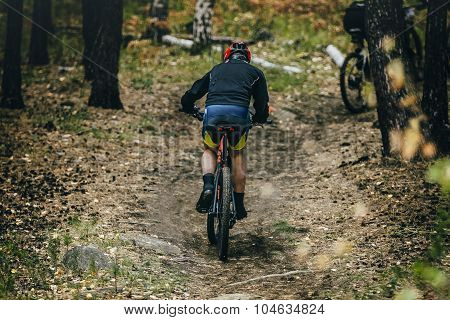 racer cyclist uphill