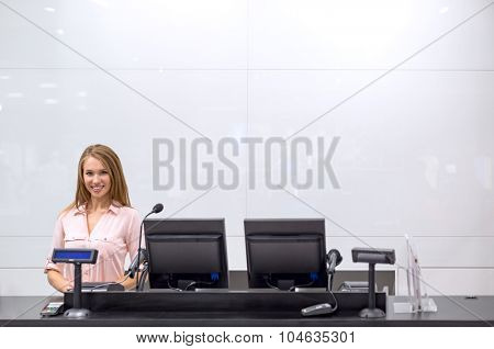 Young girl behind the counter
