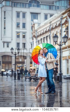 Smiling couple with an umbrella