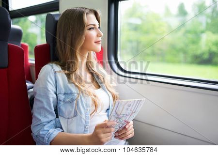 Young girl with a map of the train