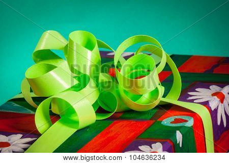 Green gift with  bow and ribbon for Christmas