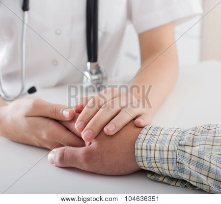 Doctor's And Patient's Hand