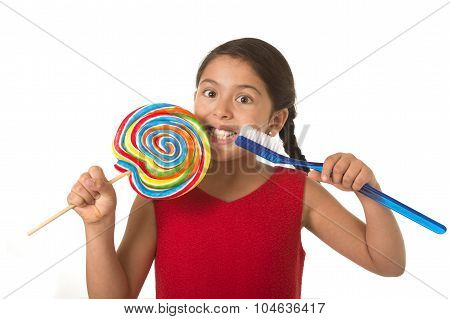 Cute Female Child Holding Big Spiral Lollipop Candy And Huge Too