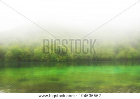 Landscape of a beautiful lake on a foggy day