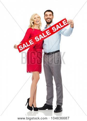 people, sale, discount and holidays concept - happy couple with red sale sign