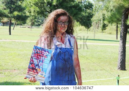 MUSKOGEE, OK - Sept. 12: Zombies roams the fields during the Castle Zombie Run at the Castle of Muskogee in Muskogee, OK on September 12, 2015.