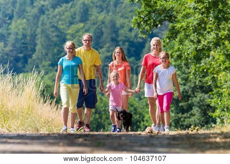 Family having walk on path in the woods