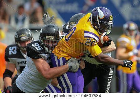 VIENNA, AUSTRIA - JULY 13, 2014: RB Islaam Amadu (#20 Vikings) runs with the ball during an Austrian football league game.