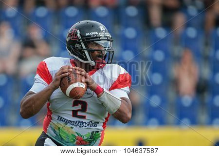 ST. POELTEN, AUSTRIA - JULY 26, 2014: QB Phillip Garcia (#2 Lions) passes the ball during Silver Bowl XVII.