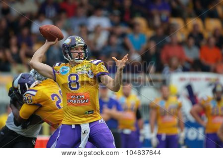 VIENNA, AUSTRIA - JULY 13, 2014: QB Christoph Gross (#8 Vikings) passes the ball during an Austrian football league game.