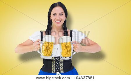 Pretty oktoberfest girl holding beer tankards against yellow vignette