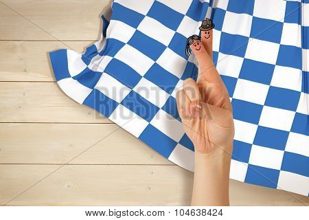 Oktoberfest character fingers against bleached wooden planks background