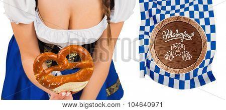 Oktoberfest girl bending and showing pretzel against oktoberfest graphics