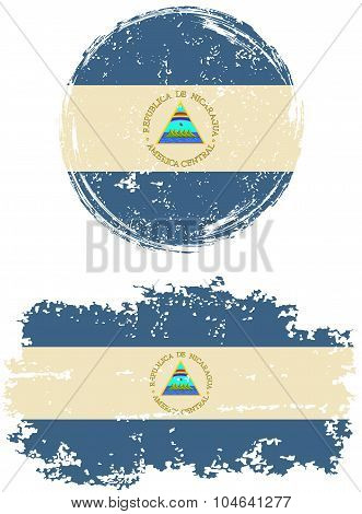 Nicaraguan round and square grunge flags. Vector illustration.