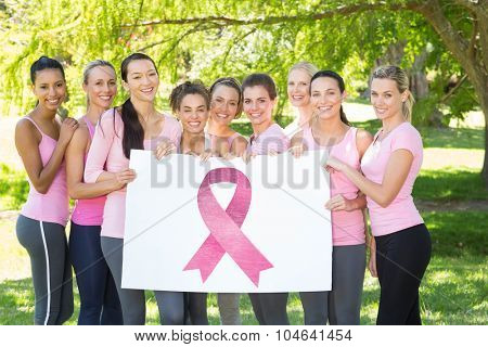 Breast cancer awareness message against smiling women in pink for breast cancer awareness