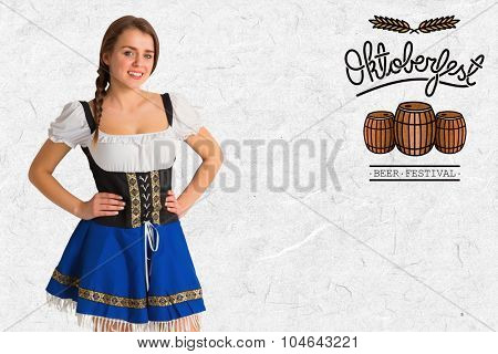 Pretty oktoberfest girl smiling at camera against parchment