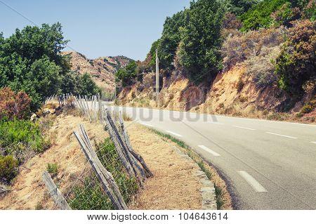 Turning Rural Asphalt Road In Mountains