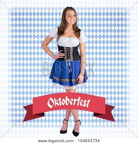 Oktoberfest girl smiling at camera against blue pattern