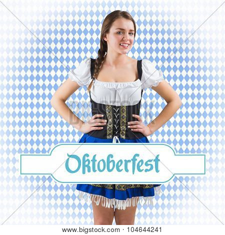 Pretty oktoberfest girl with hands on hips against blue pattern