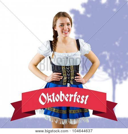 Pretty oktoberfest girl smiling at camera against oktoberfest banner