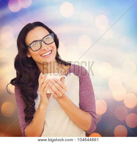 Brunette with mug against glowing background