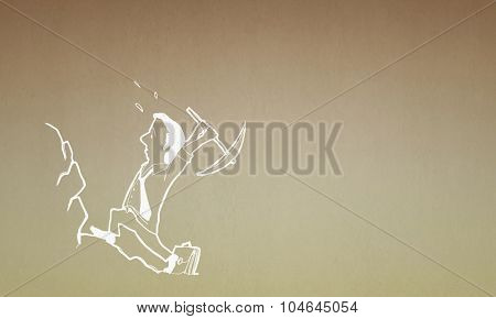 Caricature of funny businessman with pick in hands